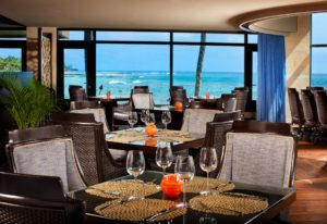 "Enjoy""Hawaii-rooted cuisine with a global influence""...with oceanfront views at Sheraton Kauai Resort's RumFire."
